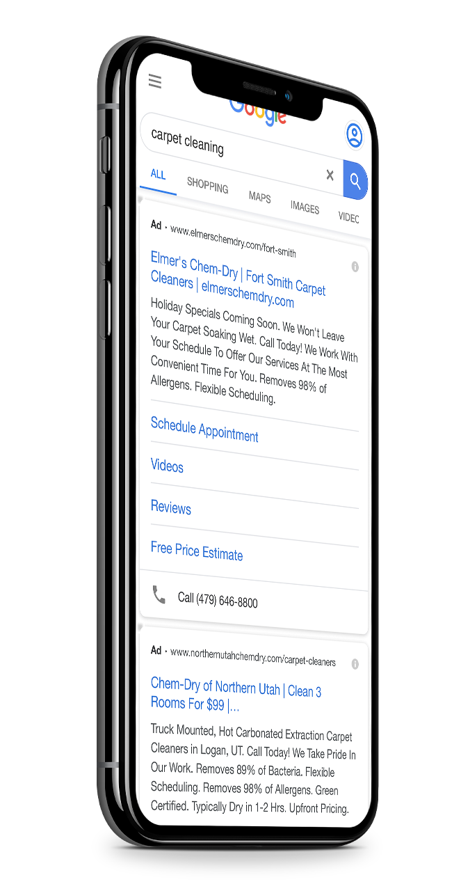 mobile phone showing google search results page and paid ads