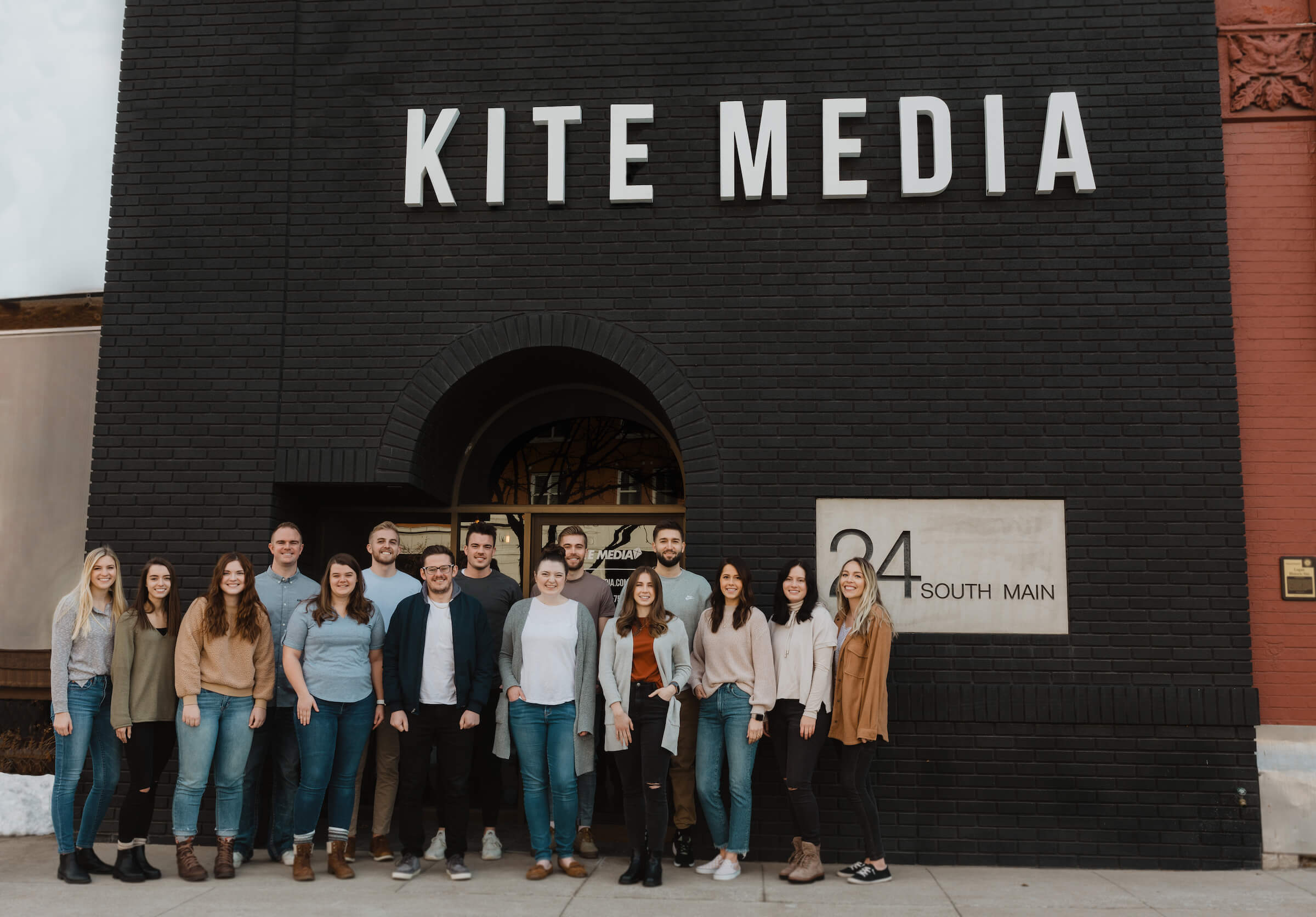 kite media team standing in front of office building